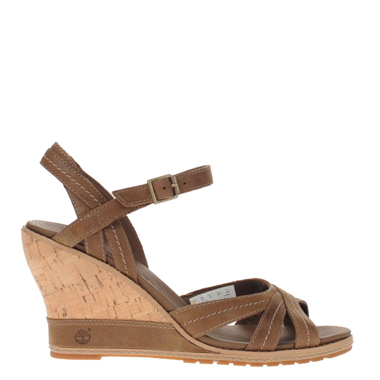 Dames sandaal op sleehak van het merk timberland uitgevoerd in bruin leer met verstelbaar bandje. de sandaal ...